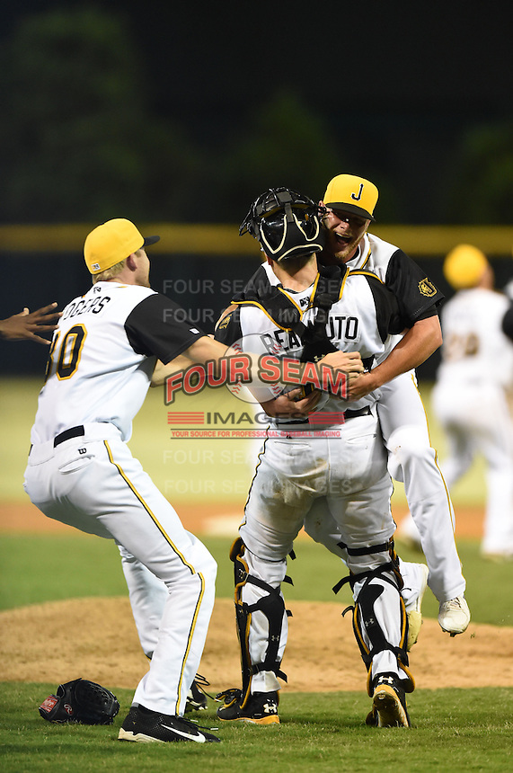 Jacksonville Suns pitcher Frankie Reed (28) celebrates with catcher J.T. Realmuto (11), as pitcher Jay Rogers (30) joins, after closing out game three of the Southern League Championship Series against the Chattanooga Lookouts on September 12, 2014 at Bragan Field in Jacksonville, Florida.  Jacksonville defeated Chattanooga 6-1 to sweep three games to none.  (Mike Janes/Four Seam Images)