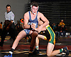 Nick Garone of Eastport-South Manor, left, battles Donny Donnelly of Ward Melville at 170 pounds during the Suffolk County varsity wrestling Division I semifinals at Hofstra University on Sunday, February 15, 2015.Garone scored to a two point takedown in the final seconds to won the match over top-seeded Donnelly by decision 4-3.<br /> <br /> James Escher