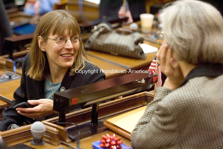 HARTFORD, CT- 07 JANUARY 2008 --010709JS11-Rep. Annie Hornish, D-Granby, left, talks with Rep. Barbara L. Lambert D-Milford, on Wednesday during the opening day of the general assembly at the state Capitol in Hartford. <br /> Jim Shannon / Republican-American