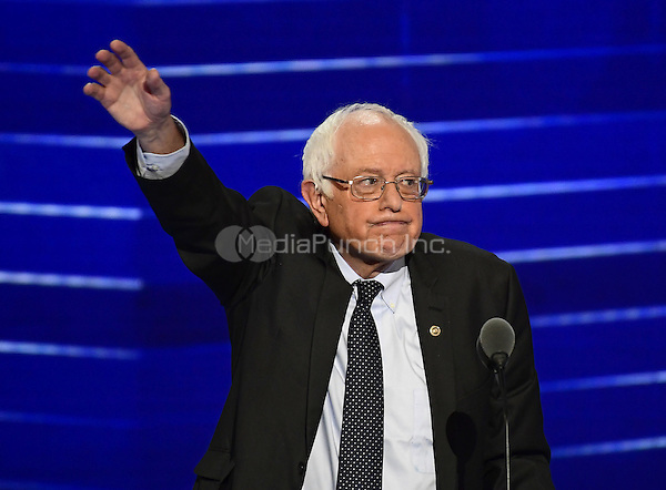 United States Senator Bernie Sanders (Independent of Vermont) waves after completing his remarks at the 2016 Democratic National Convention at the Wells Fargo Center in Philadelphia, Pennsylvania on Monday, July 25, 2016.<br /> Credit: Ron Sachs / CNP/MediaPunch<br /> (RESTRICTION: NO New York or New Jersey Newspapers or newspapers within a 75 mile radius of New York City)