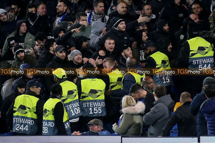 Chelsea stewards try to keep the PAOK Salonika supporters away from the Chelsea fans during Chelsea vs PAOK Salonika, UEFA Europa League Football at Stamford Bridge on 29th November 2018