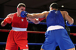 Patrick Ferguson, left, and Joshua Temple compete in the U.S. Olympic Boxing Trials in Reno, Nev., on Wednesday, Dec. 9, 2015. (AP Photo/Cathleen Allison)