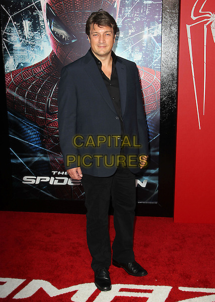 "Nathan Fillion.Los Angeles Premiere Of ""The Amazing Spider-Man"" Held The at Regency Village Theatre, Westwood, California, USA..June 28th, 2012.full length black suit blue jacket trousers .CAP/ADM/FS.©Faye Sadou/AdMedia/Capital Pictures."