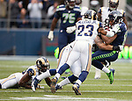 Seattle Seahawks wide receiver Golden Tate (81) is hit by St. Louis Rams linebacker James Laurinaitis (55) and safety Rodney McLeod (23) after catching a 12-yard pass during the third quarter at CenturyLink Field in Seattle, Washington on December 29, 2013.  Tate caught eight passes for 129 yards and one touchdown as Seahawks clinched the NFC West title and home-field advantage throughout the playoffs with a 27-9 victory over the St. Louis Rams.    ©2013. Jim Bryant Photo. ALL RIGHTS RESERVED.