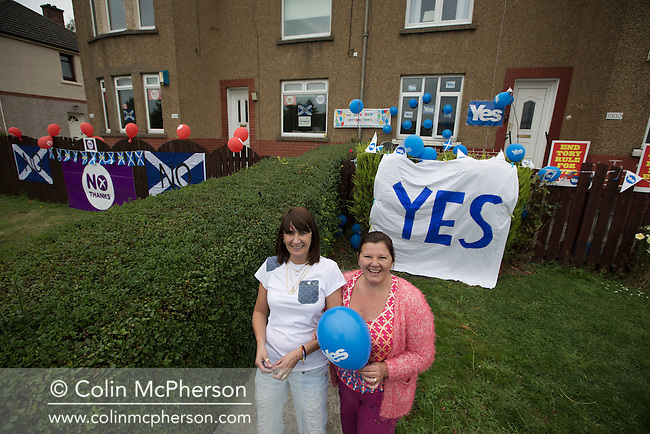 Pro-Scottish independence supporters Karen Clarkson (right) and Ann Shields in the front of their house in Cardonald, Glasgow on the day of the independence referendum. Yes Scotland were campaigning for the country to leave the United Kingdom, whilst Better Together were campaigning for Scotland to remain in the UK. On the 18th of September 2014, the people of Scotland voted in a referendum to decide whether the country's union with England should continue or Scotland should become an independent nation once again and leave the United Kingdom.