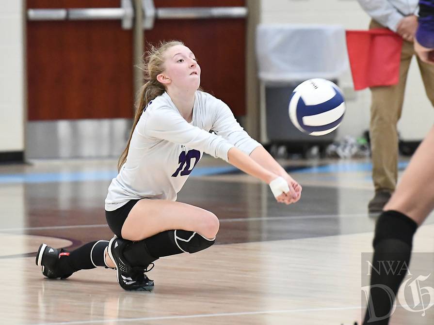 NWA Democrat-Gazette/J.T. WAMPLER Fayetteville's Carley Galloway digs a serve from Springdale Har-Ber Tuesday Oct. 10, 2017 at Wildcat Arena in Springdale. Springdale Har-Ber beat Fayetteville in 5 sets (22-25, 25-19, 25-21, 23-25, 20-18).