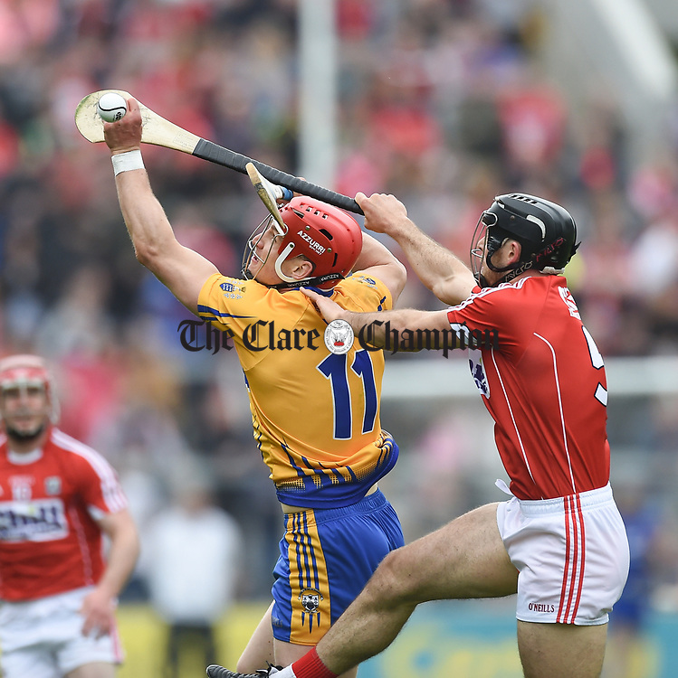 John Conlon of Clare in action against Christopher Joyce of Cork during their Munster Senior game at Pairc Ui Chaoimh. Photograph by John Kelly.