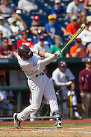 Mississippi State outfielder Hunter Renfroe (34) swings the bat during Game 11 of the 2013 Men's College World Series against the Oregon State Beavers on June 21, 2013 at TD Ameritrade Park in Omaha, Nebraska. The Bulldogs defeated the Beavers 4-1, to reach the CWS Final and eliminating Oregon State from the tournament. (Andrew Woolley/Four Seam Images)