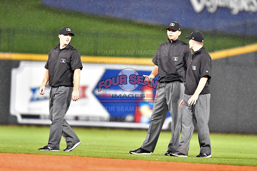 South Atlantic League umpires Mark Stewart, Emil Jimenez and Sam Burch during the South Atlantic League All Star Game at Spirit Communications Park on June 20, 2017 in Columbia, South Carolina. The game ended in a tie 3-3 after seven innings. (Tony Farlow/Four Seam Images)