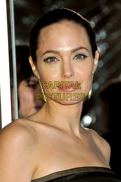 "ANGELINA JOLIE .""The Curious Case of Benjamin Button"" Los Angeles Premiere at Mann's Village Theatre, Westwood, CA, USA, .08 December 2008..portrait headshot hair up scraped back gold dangly earrings strapless back eyeliner.CAP/ADM/BP.©Byron Purvis/Admedia/Capital PIctures"