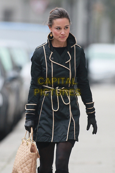 Pippa Middleton arrives for work, London, England..November 23rd, 2011.half 3/4 length black max white cream trim beige bag purse tights gloves looks tired sleepy .CAP/HIL.©John Hillcoat/Capital Pictures .