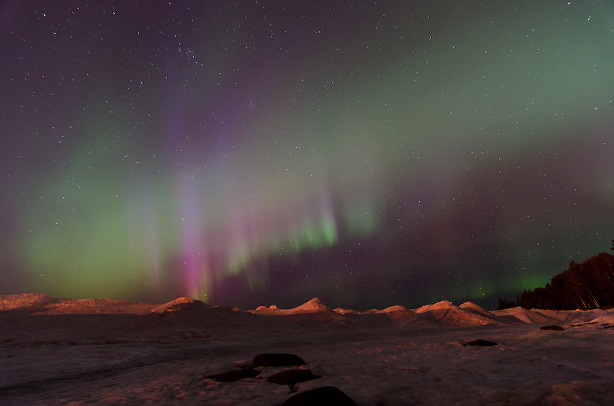 A beautiful range of colorful auroras dancing over the icy shoreline of Lake Superior. Marquette, MI