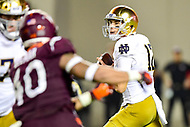 Blacksburg, VA - OCT 6, 2018: Notre Dame Fighting Irish quarterback Ian Book (12) looks down field to pass during first half action of game between Notre Dame and Virginia Tech at Lane Stadium/Worsham Field Blacksburg, VA. (Photo by Phil Peters/Media Images International)