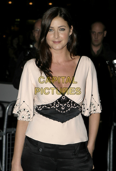 LISA SNOWDON.De-Lovely Charity Premiere, empire Leicester Square, London, September 29th 2004..half length black and white cream twenties style art deco top black trousers.Ref: AH.www.capitalpictures.com.sales@capitalpictures.com.©Capital Pictures.