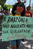 "Belem, Para State, Brazil. Demonstration against the construction of the Belo Monte hydroelectric dam, 20th August 2011. Girl with hand-written sign ""Amazonia will not continue to suffer being violated""."