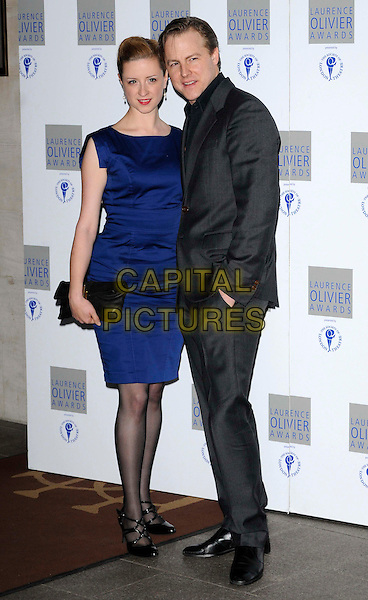 GUEST & SAMUEL WEST.The Laurence Olivier Awards 2010, Grosvenor House Hotel, London, England. .21st March 2010.full length blue dress grey gray suit.CAP/CAN.©Can Nguyen/Capital Pictures.