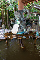 Anrakuji Temple Water Fountain - the original site of the temple was 2 km from its present location where Kobo Daishi created a hot spring that was renowned for its healing properties. The temple was moved to its present location, and made ito a roadside temple to provide lodging for pilgrims.  Within its grounds is a two storey pagoda, a beautiful pond garden and a bamboo grove. Anrajkuji is entered through a big, white, Chinese-style gate,  and up the stairs by the gatehouse Anrakuji offers a tsuyado - free lodgings for walking pilgrims.  Anrakuji also has a shukubo of temple lodging at nominal cost.  Anrakuji has a long history of accommodating pilgrims, in part because of its location that is accessible if one were to start at temple 1 early in the morning it would be possible to reach by late afternoon.