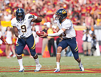 September 22, 2012: California's Zach Maynard hands off the ball to C.J. Anderson during a game against USC at the Los Angeles Memorial Coliseum, Los Angeles, Ca  USC defeated California 27- 9
