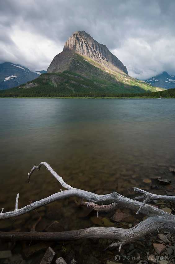 Grinnell Point on Swiftcurrent Lake and twisted tree branch