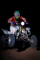 A quad rider jumps through the night during and MRAN night race in Logandale, NV.