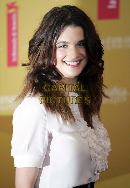 "RACHEL WEISZ.Photocall for ""The Fountain"" at the 63rd Venice International Film Festival, Venice, Italy..September 4th, 2006.Ref: OME.headshot portrait white ruffles top blouse.www.capitalpictures.com.sales@capitalpictures.com.©Omega/Capital Pictures."