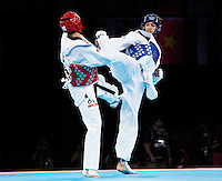 10 AUG 2012 - LONDON, GBR - Ramin Azizov (AZE) (right) of Azerbaijan aims a kick at Steven Lopez of the USA during their men's -80kg category preliminary round contest at the London 2012 Olympic Games Taekwondo at Excel in London, Great Britain .(PHOTO (C) 2012 NIGEL FARROW)