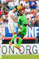 June 07, 2014:   the United States of America defender Geoff Cameron (20) and Nigeria forward Emmanuel Emenike (9) both try to head the ball during action between the USA Men's National Soccer team and Nigeria at EverBank Field in Jacksonville, Florida.  This is the last match before the USA team leaves for Brazil and the 2014 World Cup Championships. USA defeated Nigeria 2-1.