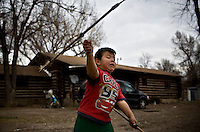 Rudy Bird Grand, 5 practices his arrow throwing skills in Lodge Grass, MT on the Crow Indian Reservation. Children on the reservation are taught the traditions of their culture's past, in hopes they will carry their culture into the future.