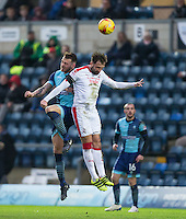 Max Muller of Wycombe Wanderers goes up with Josh Payne of Crawley Town during the Sky Bet League 2 match between Wycombe Wanderers and Crawley Town at Adams Park, High Wycombe, England on 25 February 2017. Photo by Andy Rowland / PRiME Media Images.