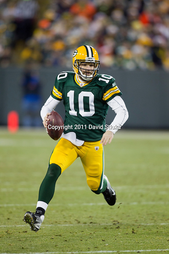Green Bay Packers quarterback Matt Flynn (10) scrambles for yardage during a week 16 NFL football game against the Chicago Bears on December 25, 2011 in Green Bay, Wisconsin. The Packers won 35-21. (AP Photo/David Stluka)