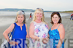 LIGHT: Betty Mulcahy, Marian Keogh and Margaret O'Sullivan at the Celebration of Light candle ceremony at Banna Strand on Sunday.