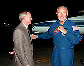 John F. Kennedy Space Center Director Roy Bridges (left) greets STS-95 Payload Specialist John H. Glenn Jr. after his arrival on a T-38 jet aircraft at the Shuttle Landing Facility at KSC on October 6, 1998. Glenn, a U.S. Senator from Ohio, and the rest of the crew are at KSC to participate in a Terminal Countdown Demonstration Test (TCDT). The TCDT includes mission familiarization activities, training in emergency exit from the orbiter and launch pad, and a simulated main engine cut-off exercise. The other crew members on the mission are Mission Commander Curtis L. Brown; Pilot Steven W. Lindsey; Mission Specialists Scott E. Parazynski, Stephen K. Robinson, and Pedro Duque of Spain, representing the European Space Agency (ESA);.and Payload Specialist Chiaki Mukai, representing the National Space Development Agency of Japan (NASDA). The STS-95 mission includes research payloads such as the Spartan solar-observing deployable spacecraft, the Hubble Space Telescope Orbital Systems Test Platform, the International Extreme Ultraviolet Hitchhiker, as well as the SPACEHAB single module with experiments on space flight and the aging process..Credit: NASA via CNP