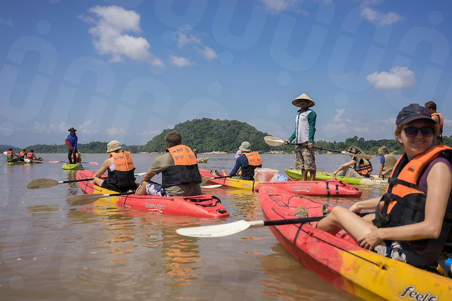 November 5, 2014 - Preah Rumkel, Stung Treng (Cambodia). A group of tourists enjoys a kayak tour in the water of the Anlung Cheauteal Pool, on the border between Laos and Cambodia. The majority of the foreigner tourists who visit this area, are backpackers from Laos. © Thomas Cristofoletti / Ruom