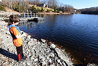 NWA Democrat-Gazette/FLIP PUTTHOFF <br /> Trevin Edwards, 8, fishes for trout Dec. 22 2018 at Lake Brittany in Bella Vista. The Bella Vista Property Owners Association stocks the lake with rainbow trout.