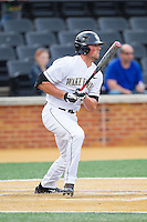 Charlie Morgan (24) of the Wake Forest Demon Deacons follows through on his swing against the Maryland Terrapins at Wake Forest Baseball Park on April 4, 2014 in Winston-Salem, North Carolina.  The Demon Deacons defeated the Terrapins 6-4.  (Brian Westerholt/Four Seam Images)