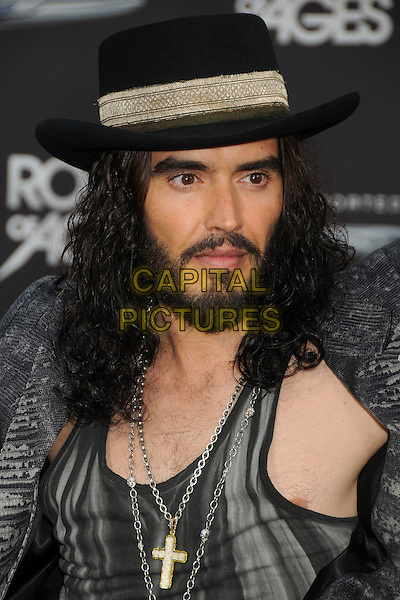 "Russell Brand.""Rock of Ages"" Los Angeles Premiere held at Grauman's Chinese Theatre,  Hollywood, California, USA,.8th June 2012..portrait headshot smiling  black  grey gray print jacket hat cross necklace beard facial hair .CAP/ADM/BP.©Byron Purvis/AdMedia/Capital Pictures."