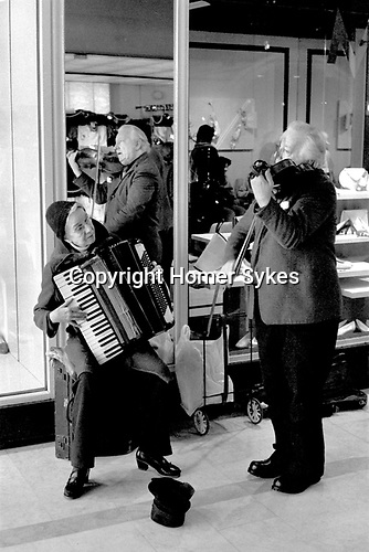 Old age pensioners , husband and wide busking on the streets of Blackburn Lancashire UK 1983.<br /> <br /> My ref 6/4490/, 1983,