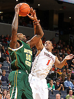 Dec. 20, 2010; Charlottesville, VA, USA; Norfolk State Spartans forward Kyle O'Quinn (10) is fouled by Virginia Cavaliers guard Jontel Evans (1) during the game at the John Paul Jones Arena. Mandatory Credit: Andrew Shurtleff