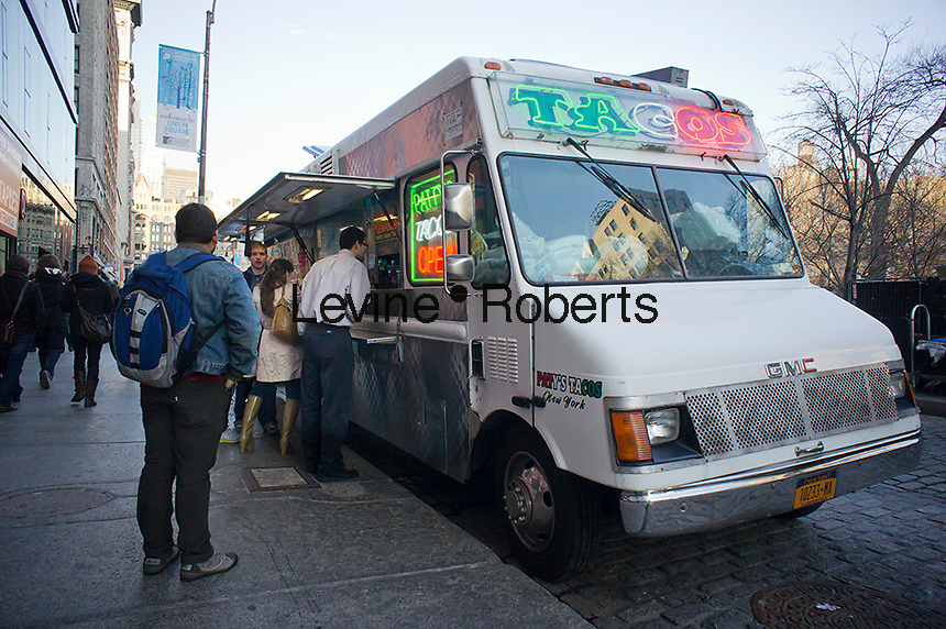Shoppers grab a bite from Paty's Taco Truck in Union Square in New York on Saturday, January 28, 2012. (© Richard B. Levine)