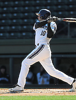 Left fielder Walker Moses (10) of the Northwestern Wildcats hits in a game against the Michigan State Spartans on Sunday, February 17, 2013, at Fluor Field at the West End in Greenville, South Carolina. Michigan State won, 7-4. (Tom Priddy/Four Seam Images)