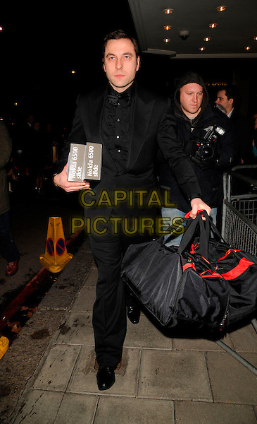 DAVID WALLIAMS .At the Cystic Fibrosis Liv Charity Event, Dorchester Hotel,.London, England, February 1st 2008..full length black shirt suit bag.CAP/CAN.?Can Nguyen/Capital Pictures