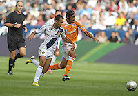 CARSON, CA - DECEMBER 01, 2012:   Juninho (19) of the Los Angeles Galaxy goes for a loose ball with Calen Carr (3) of the Houston Dynamo during the 2012 MLS Cup at the Home Depot Center, in Carson, California on December 01, 2012. The Galaxy won 3-1.