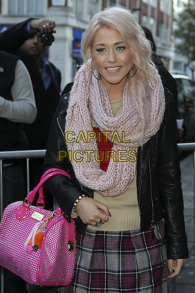 Amelia Lily.X Factor finalists at the studios of BBC Radio 1, London, England..December 5th, 2011.half length black leather jacket pink grey gray bag purse skirt kilt scarf knitted .CAP/HIL.©John Hillcoat/Capital Pictures .