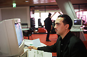 A member of the public uses the open access computer system at the new Peckham Library, London.
