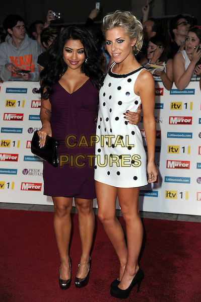 Vanessa White and Mollie King of The Saturdays.'The Daily Mirror's Pride Of Britain Awards 2011' at Grosvenor House Hotel, London, England..3rd October 2011.full length black dress shoes purple white polka dot sleeveless .CAP/CAS.©Bob Cass/Capital Pictures.