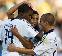 LA Galaxy defender Sean Franklin and teammates Edson Buddle and Bryan Jordan celebrate after a goal. LA Galaxy defeated the Colorado Rapids 3-2 at Home Depot Center stadium in Carson, California on Sunday October 12, 2008. Photo by Michael Janosz/isiphotos.com