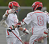 Mike Monitto #9 of Half Hollow Hills East, left, congratulates teammate Ryan Doran #8 after he scored a goal in a Suffolk County varsity boys lacrosse game against West Islip at Half Hollow Hills High School East on Tuesday, May 9, 2017. Doran tallied six goals as Hills East rallied from an early 6-2 deficit to win 14-10.