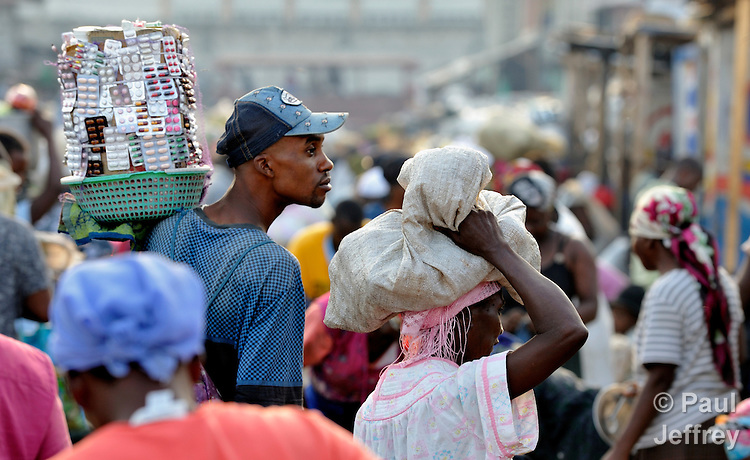 A man carries medicines to sell in the Croix-des-Bossales market in the La Saline neighborhood of Port-au-Prince, Haiti.