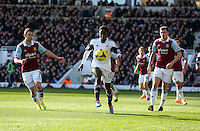 Pictured: Nathan Dyer of Swansea (C) controls the ball between Matt Jarvis (L) and George McCartney (R) of West Ham. 01 February 2014<br />