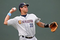 """Charleston RiverDogs players, including catcher Gary Sanchez (35), wore blue wrist bands for colon cancer awareness Sunday at Fluor Field at the West End for the """"Drive Out Colon Cancer"""" game sponsored by BlueCross BlueShield of South Carolina. The Greenville Drive lost to intrastate rival Charleston, 7-5. (Tom Priddy/Four Seam Images)"""